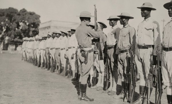 Sample Resource: A U.S. Marine inspecting a troop of Haitian soldiers, 1920.